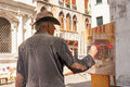 Artist paints venice scene showing artwork and subject italy Stock Photos