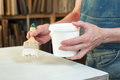 An artist priming canvas. Selective focus Royalty Free Stock Photo