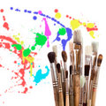 Artist's brushes with paint drops Stock Photography