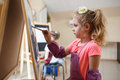 Artist school girl painting watercolor brush