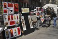 Artist stall on las ramblas barcelona spain artists selling prints and paintings pedestrian street in catalonia Royalty Free Stock Images