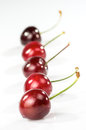 Artistic cherries macro photography of on white background Stock Images