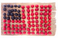 Artistic display of raspberries and blackberries arrangement in rows forming american flag for an interesting healthy fresh fruit Royalty Free Stock Photo