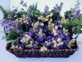 Artistic flower arrangement in cane basket a generic image but actual location was skyros a greek island Stock Images