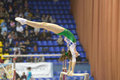 Artistic gymnastics kiev ukraine march elena rega uzbekistan performs exercise on uneven bars during international tournament in Royalty Free Stock Image