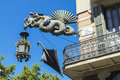 Artistic lamppost in les rambles of barcelona decorated with a dragon a fan and an umbrella catalonia spain Stock Images