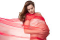 Artistic portrait beautiful expectant mother cradling her bare pregnant belly her hands red chiffon scarf draped around her blows Stock Images