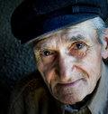 Artistic portrait of friendly senior old man Stock Photography