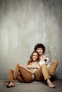 Artistic portrait of a young couple on a gray Royalty Free Stock Photo