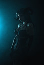 Artistic shot of a sensual gothic girl with horns on blue smoky background halloween theme Stock Photos