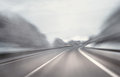 Artistic winter highway driving danger fast at the motion blur visualizies the speed and dynamics Stock Photo