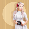Artistic woman holding retro camera while standing on creative circle background Stock Photos