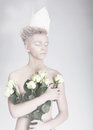 Artistry trendy young man in paper crown with flowers fashionable Royalty Free Stock Image