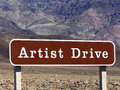 Artists drive sign board at death valley np the face of the black mountains along is made up of the multicolored rock of the Stock Image