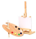 Artists easel photo of an with a blank canvas plus palette of paint and brushes isolated on a white background Royalty Free Stock Photos