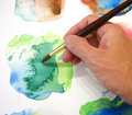 Artists hand painting Stock Photography