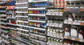 Artists materials paints in a store various for sale including tubes of oil and varnish Stock Photography