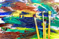 Artists oil paints multicolored abstract texture with brushes top view Royalty Free Stock Photo