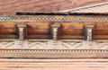 artsy decor trim and classic old wooden house. triangular patterns wood texture brick color.