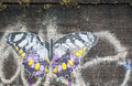Artwork representing a big butterfly on a brick wall shoreditch london uk september street art in london Royalty Free Stock Photography