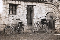Artwork in vintage style bicycles rustic house Royalty Free Stock Image
