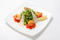 Arugula fresh salad with avocado slices with Parmesan cheese and fried shrimp flavored with balsamic vinegar Royalty Free Stock Photo