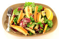 Arugula and radicchio gourmet salad with added slices pear bosc croutons on top garnished with parmesan shavings walnuts in Royalty Free Stock Images