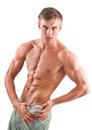 Aryan looking young bodybuilder portrait of a muscular man with a half naked body Stock Photography