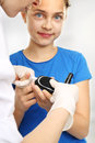 As you explore sugar baby measure blood glucose levels using a glucometer girl with diabetes to Stock Photography