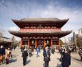 Asakusa tokyo visitors pass the hozomon gate at senso ji temple february in jp founded in it is s oldest shrine and one of the Stock Photography