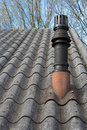 Asbestos Country House Roof with chimney Stock Image