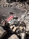 Asbestos warning sign laying among asbestos debris Royalty Free Stock Photo