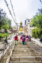 Ascend to the temple people are climbing up stairs swayumbanath kathmandu nepal Royalty Free Stock Images
