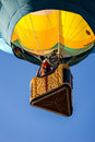 Ascending in a hot air balloon reno september colorful rises into the clear blue sky during the mass ascension at the th annual Royalty Free Stock Photography