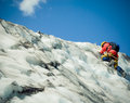 Ascending mountaineer makes his way up to the top Stock Image