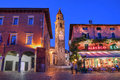 Ascona switzerland night scene in the resort town of ticino featuring the bellfry of the parish church of ss piedro and paolo Royalty Free Stock Images