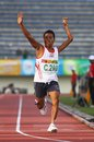 Asean paragames athletic indonesian disabled sprinter sutimin expressing his winning for a gold medal at asian held in solo Stock Photo