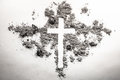 Ash wednesday cross, crucifix made of ash, dust as christian rel Royalty Free Stock Photo