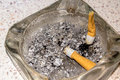 Ashes in an ashtray with cigarette residue Royalty Free Stock Image