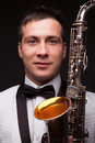 Ashionable man with sax closeup of fashionable modern musician Royalty Free Stock Images