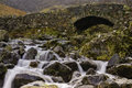 Ashness bridge lake district england a downstream view of the stone a very popular landmark with photographers and tourists in Stock Photography