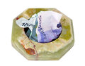 Ashtray with money crumpled are located in the the depreciation of Stock Image