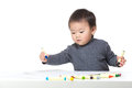 Asia baby boy concentrate on drawing Royalty Free Stock Images
