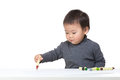 Asia baby boy concentrate on drawing isolated white Stock Photo