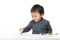 Asia baby boy concentrate on drawing isolated white Stock Photography