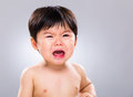 Asia baby boy cry with gray background Royalty Free Stock Image