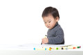 Asia baby boy focus on drawing Royalty Free Stock Photo