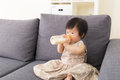 Asia baby girl feed with milk bottle at home Royalty Free Stock Image