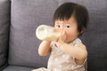 Asia baby girl having milk at home Royalty Free Stock Photo