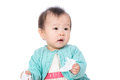 Asia baby girl play tissue Royalty Free Stock Photography